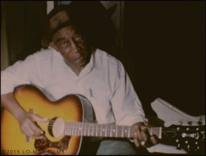 "First ever color film footage of Mississippi John Hurt by K. Swerilas, here performing ""Louis Collins"". Image from collection of Lo-Max Films Ltd."